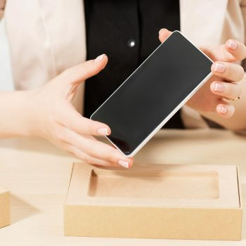 Female hands holding new smartphone