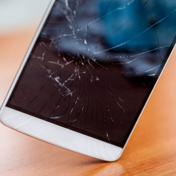 Broken screen glass of a smartphone after falling on the ground